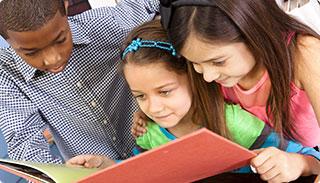 diverse children reading together